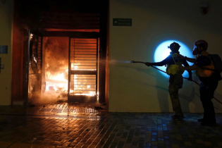 Hong Kong rioters set fire on coronavirus affected house