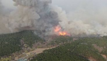 Thousands battle mountain fire in northeast China
