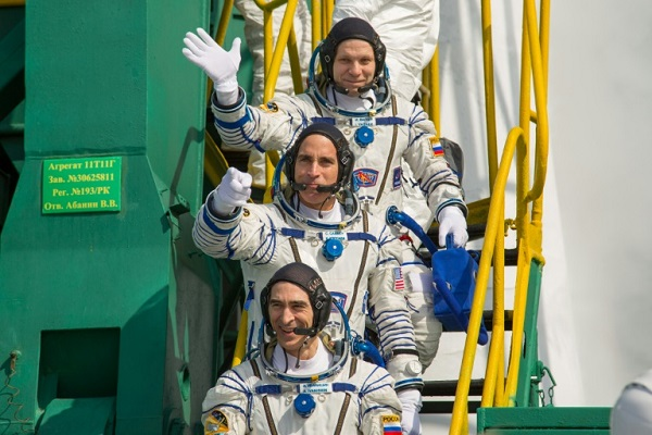 Three-man US-Russian crew returns to Earth from ISS