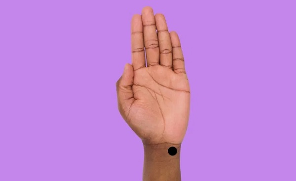 The spirit gate point is located at the crease on outer wrist, below pinkie finger.